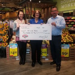 Barrett Johnson, on right, store manager at Hannaford Supermarket in Scarborough, presents Susan Gold, center, and Cindy DiBiase, left, with a check for $500 for Vet to Vet Maine.