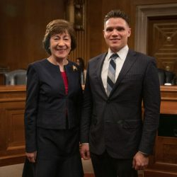 Vet2Vet Maine volunteer Ben Wells poses with Sen. Susan Collins after testifying before Congress on Nov. 6.